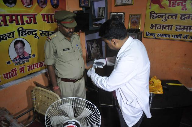 The pistol revovered from the crime spot and the grieving kin of Tiwari(HT Photos)