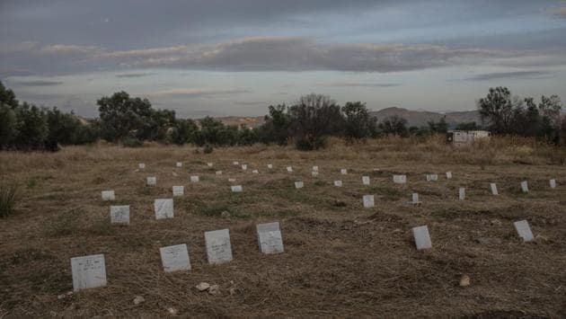 "Tombstones marking the graves of migrants and refugees who drowned at sea while crossing from nearby Turkey are seen at a cemetery near the village of Kato Tritos. The surge started before Turkey's military offensive against Kurdish fighters in Syria. Since the offensive began last week, Turkish President Recep Tayyip Erdogan has sought to quell European criticism by warning that he could ""open the gates"" and send more than 3 million Syrian refugees to Europe. (Petros Giannakouris / AP)"