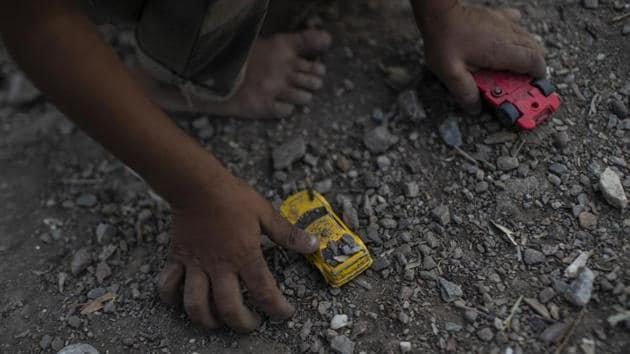 A Syrian boy plays with a toy car at the Moria refugee and migrant camp on the Greek island of Lesbos. More than 12,000 people are currently housed in Moria following a spike in migrant arrivals over the summer. The Greek government promised to accelerate transfers to the mainland and expand the network of camps there. But those transfers have so far been outnumbered by new arrivals on the islands. (Petros Giannakouris / AP)