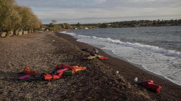 Life vests are seen on a beach at the seaside village of Tsonia, Lesbos island, Greece after the arrival of refugees and migrants on a rubber boat from Turkey. Greece's eastern islands are struggling to cope with a surge in arrivals of migrants and asylum-seekers that has undermined efforts to ease severe overcrowding at refugee camps. (Petros Giannakouris / AP)