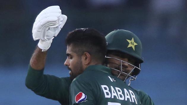 File image: Pakistan's captain Sarfaraz Ahmed, right, greets Babar Azam.(AP)