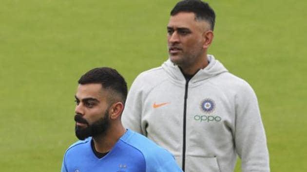 India's captain Virat Kohli, left, and MS Dhoni attend a training session.(AP)