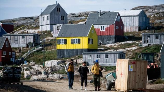 Many of the 85,000 tourists who visit each year head to the west coast, but eastern Greenland, with its glaciers, wilderness and wildlife starring whales and polar bears, is also drawing visitors. Sarah Bovet, a Swiss artist, was on an artistic residency in Greenland when she visited Kulusuk and its 250 souls. Although she had imagined a small village before arriving, its stunning views and bright colours still came as a surprise. (Jonathan Nackstrand / AFP)