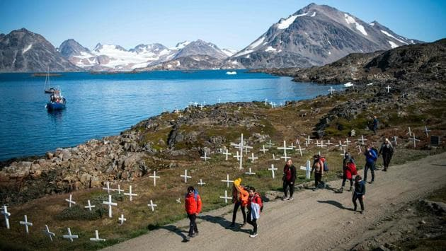 Andrea Fiocca (L), Italian researcher and tour guide leads a group of tourists in Kulusuk. The growth in tourism could put a strain on the village's infrastructure, and the sector faces unique challenges given Greenland's location, weather and the cost of travelling there. Day tours of Kulusuk with flights from the Icelandic capital Reykjavik are 97,000 Icelandic kronur ($780, 700 euros). (Jonathan Nackstrand / AFP)