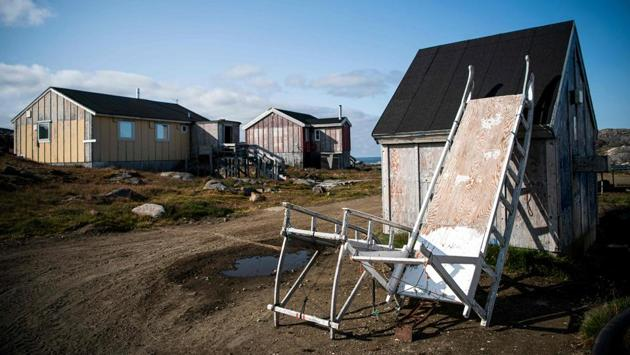 """""""If you want nature to survive that, you have to build up the infrastructure,"""" Johanna Bjork Sveinbjornsdottir said, who runs tours in Kulusuk for an Iceland-based company, pointing to the lack of officially designated campsites around Kulusuk, with no rubbish bins or toilets for travellers outdoors and no one supervising the sites. Despite the concerns, Sveinbjornsdottir hopes visitors will keep coming.""""They go back as different people,"""" she said. """"Everything is beyond what you ever imagined."""" (Jonathan Nackstrand / AFP)"""