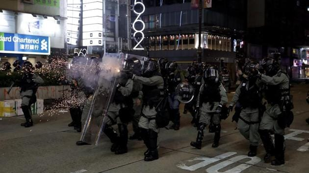 Police fire tear gas to disperse protesters in Hong Kong.(AP Photo)