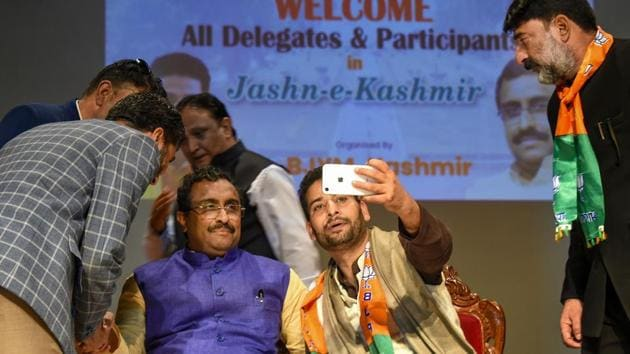"""A supporter takes selfies with BJP National General Secretary Ram Madhav at the party's """"Jashn-e-Kashmir"""" function, in Srinagar, Sunday, Oct. 20, 2019.(PTI)"""