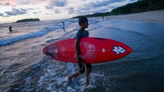"""Ngwe Saung is the heartland of the growing craze and has now hosted several competitions.""""We hadn't heard of surfing before 2017,"""" said Aung Min Naing, 19. But he is """"so excited"""" to represent Myanmar at the upcoming games.""""It will be a difficult competition but we will do our best for sure."""" (Ye Aung Thu / AFP)"""