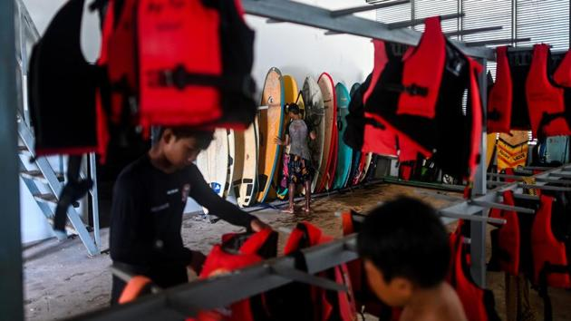 The Surf Association of Myanmar was established only this year. The sport is slowly gaining prominence thanks to the impassioned surfers, most from a village near the beach and newcomers themselves. (Ye Aung Thu / AFP)