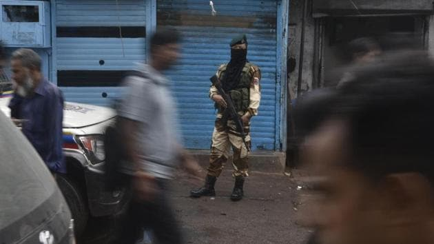 A defence personnel stands guard during the polls at Bandra in Mumbai. The electoral fate of 3,237 candidates in the Maharashtra will be sealed in the EVMs. Of the 288 seats, BJP is contesting on 164; this includes candidates of smaller allies contesting on its lotus symbol, while its key ally Shiv Sena has fielded 126 candidates. On the other hand, Congress has candidates in 147 constituencies and NCP is contesting 121 seats. (Kunal Patil / HT Photo)