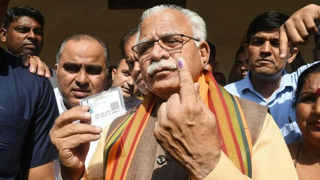 Haryana Chief Minister Manohar Lal Khattar shows his finger marked with indelible ink after casting vote in Karnal. While Khattar claimed that BJP will easily achieve its target of winning over 75 seats, Congress' Bhupinder Singh Hooda claimed that his party will make a comeback in the state. (PTI)