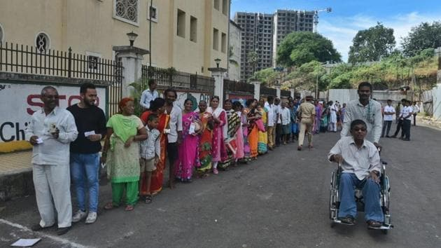 People queue at a polling station to cast their vote at Pawar Public School, at Chandivali in Mumbai. The state assembly elections for Haryana and Maharashtra began at 7 am today and will continue till 6 pm in the evening. The polling is for 90 seats of Haryana and 288 constituencies of Maharashtra and has largely remained peaceful, with each major party predicting its win in the elections. (Satyabrata Tripathy / HT Photo)
