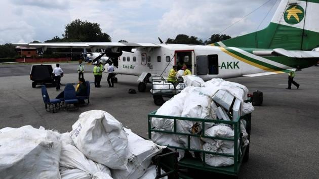 """Nepali airline staff unload waste collected from the Everest region, at Tribhuvan airport in Kathmandu. """"Waste doesn't need to be wasted,"""" Nabin Bikash Maharjan of local recycling organisation Blue Waste to Value (BW2V) told AFP. (Prakash Mathema / AFP)"""