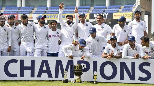 Ranchi: Indian captain Virat Kohli and team players pose with the trophy.(PTI)