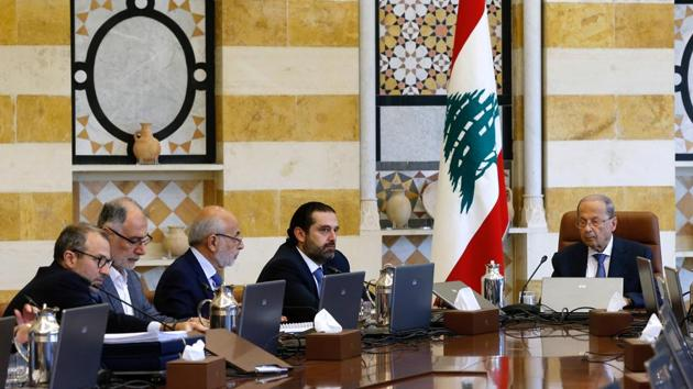 Lebanon's President Michel Aoun (R) presides a cabinet session at the Baabda palace. Hariri said that the Cabinet approved the 2020 budget with a deficit of 0.63% with no new taxes. The reforms include of the salaries of ministers and lawmakers, overhauling the electricity sector, working to scrapping the ministry of information and other public institutions and downsizing others. (Mohamed Azakir / REUTERS)