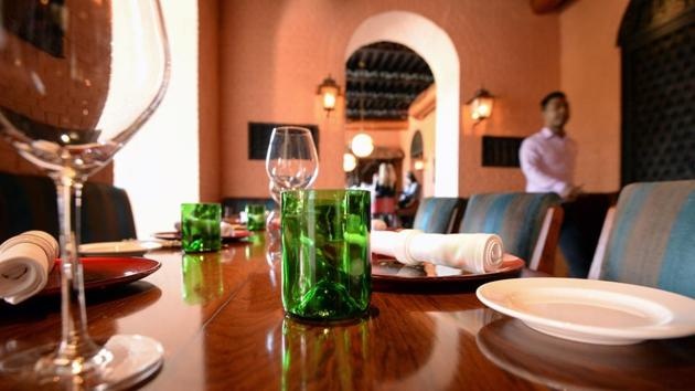 A cup (C) cut from glass collected as waste on Mount Everest, is seen at a restaurant in Kathmandu. Aanchal Malla of Hotel Yak & Yeti, a luxury five-star hotel in Kathmandu, said opting for the upcycled goods was in-line with the hotel's move towards sustainable and environmentally friendly products. (Prakash Mathema / AFP)