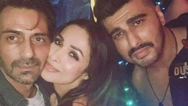 Malaika Arora poses with her boyfriend Arjun Kapoor and Arjun Rampal during her birthday bash.