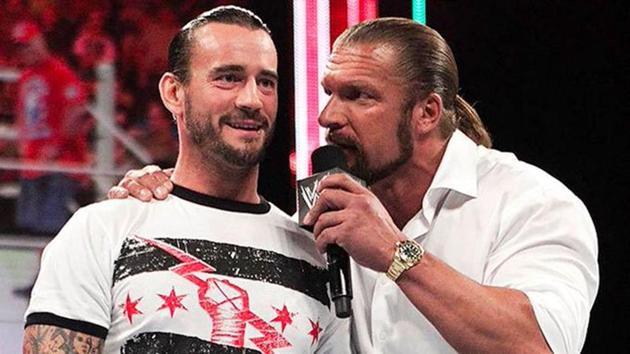 CM Punk (L) and Triple H.(Twitter)