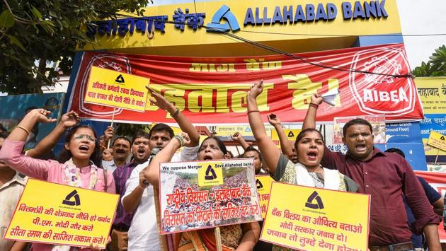 "Employees hold placards during the strike in Patna, Bihar. A senior banker, however, said the protests would not derail the merger plans. ""We have seen that the unions had taken similar steps even in the last round of merger which included the State Bank of India and then in the case of Bank of Baroda but it quietly died down later,"" said the CEO of a public sector bank, requesting anonymity. (PTI)"
