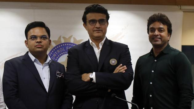 Newly-elected President of the Board of Control for Cricket in India (BCCI) Sourav Ganguly, center, Secretary Jay Shah, left, and Treasurer Arun Dhumal stand for a photograph during a press conference in Mumbai.(AP)