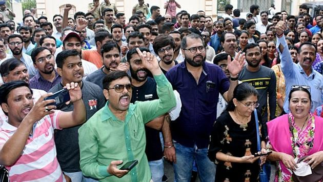 "Employees raise slogans during a protest in Surat, Gujarat. ""Already the government has effected the merger of associate banks with SBI and Dena Bank and Vijaya Bank with Bank of Baroda, and in this process around three thousand bank branches have been closed. If this (of 10 banks) merger takes place may be another two thousand bank branches will be closed,"" AIBEA said. (ANI)"