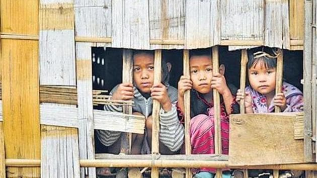 As per the instructions of the MHA, supplies of ration and cash benefits to the Bru camps were stopped since October 1, two days before the repatriation began. Over 37,000 Bru people had taken shelter in Tripura to escape an ethnic clash in Mizoram in 1997. In this file picture, 3 Bru children seen at a relief camp in Northern part of Tripura.(HT Archive)
