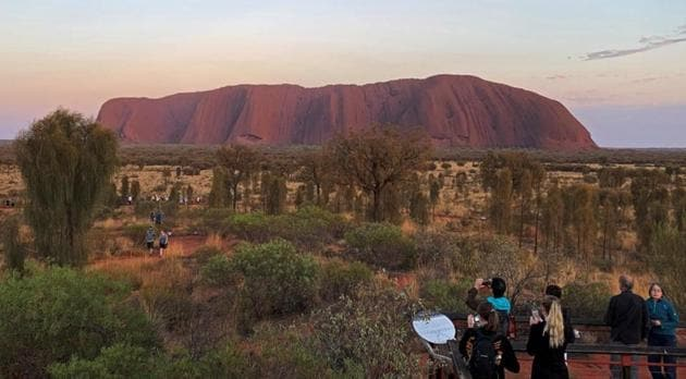 People view Uluru, formerly known as Ayers Rock, the day before a permanent ban on climbing the monolith takes effect following a decades-long fight by indigenous people to close the trek, near Yulara, Australia, October 25, 2019.(REUTERS)