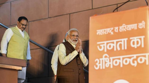 Prime Minister Narendra Modi arrives to address his supporters after the party's victory in both Haryana and Maharashtra Assembly polls, at BJP HQ, in New Delhi.(PTI)