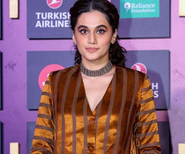 Tapsee Pannu poses for photographs as she attends the opening ceremony of Jio MAMI 21st Mumbai Film Festival in Mumbai. (PTI)