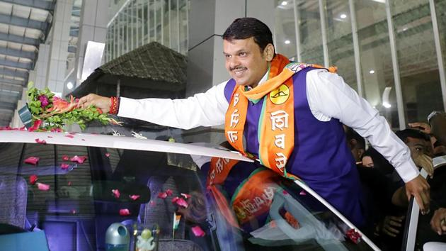 Maharashtra Chief Minister and BJP leader Devendra Fadnavis, celebrates his victory, in Nagpur on Thursday.(ANI Photo)