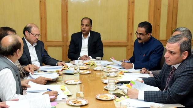 Chief minister Jai Ram Thakur along with officials during the meeting of State Single Window Clearance & Monitoring Authority in Shimla on Friday.(HT photo)