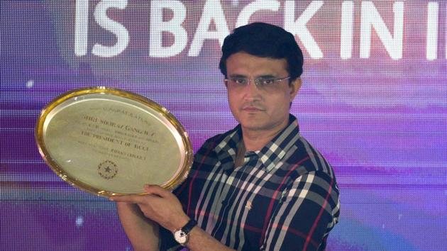 Newly elected BCCI President Sourav Ganguly holds a memento that was presented to him during a felicitation program by Cricket Association of Bengal (CAB), at Eden Garden.(Samir Jana / Hindustan Times)