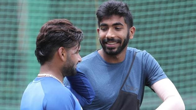 Jasprit Bumrah, right, shares a light moment with fellow cricketer Rishabh Pant.(AP)