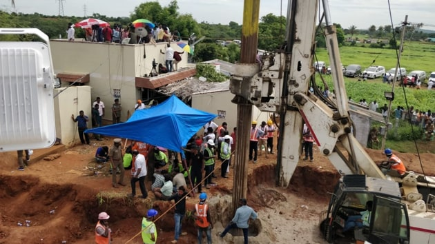 A boring machine at work near a borewell where a two-year-old child has been stuck since Friday near Trichy.(Sourced Photo)