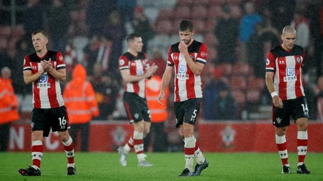 Southampton's Jack Stephens, James Ward-Prowse and Oriol Romeu look dejected at the end of the match.(REUTERS)