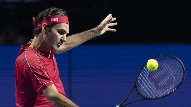 Switzerland's Roger Federer returns a ball.(AP)