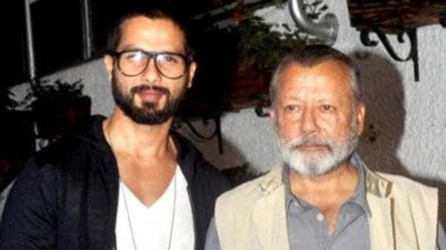 Shahid Kapoor poses with dad Pankaj Kapur at an event.