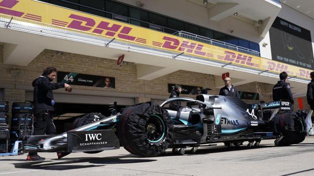 Mercedes driver Lewis Hamilton sits along pit lane.(AP)