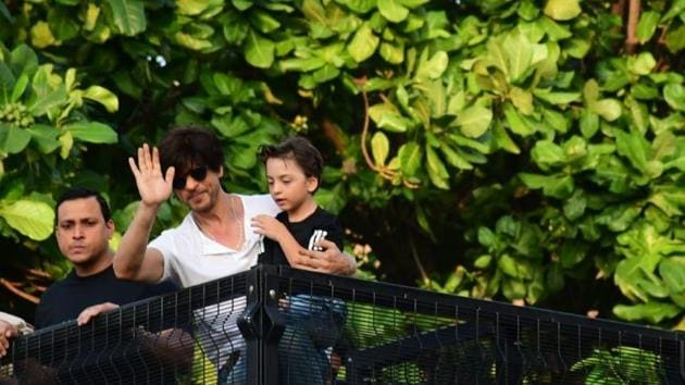 Shah Rukh Khan waves to fans on his birthday as son Abram looks on.(Varinder Chawla)