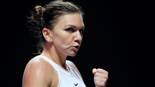 Romania's Simona Halep reacts during her group stage match against Czech Republic's Karolina Pliskova.(REUTERS)