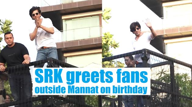 Shah Rukh Khan greets fans outside his Mumbai residence, Mannat. The actor celebrated his 54th birthday on 2nd November. Fans gathered to catch a glimpse of the actor and wish the 'King of Bollywood'. Shah Rukh Khan was spotted in a white T-shirt and denims. He greeted the multitude of fans with his son AbRam. Shah Rukh was also seen striking his signature pose with his arms wide open.