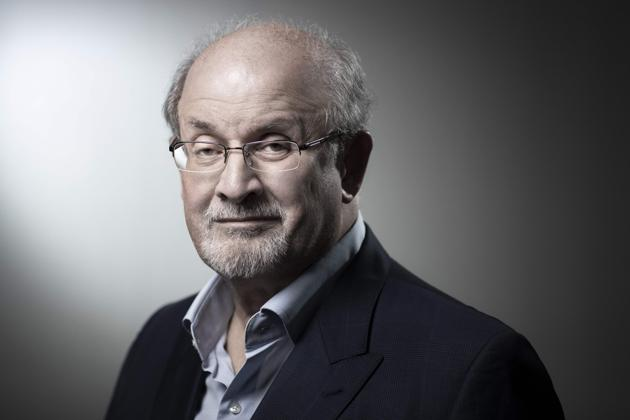 """(FILES) In this file photo taken on September 10, 2018 now US novelist and essayist Salman Rushdie poses during a photo session in Paris. - The author of the """"Satanic Verses"""", now US novelist and essayist Salman Rushdie, refuses to live as a recluse but he accepted to live under police protection since the Ayatollah Khomeini, the first guide of the Islamic Republic of Iran put a fatwa on a him and condemned him to death sentence for the book deemed as blasphemous by Muslims. (Photo by JOEL SAGET / AFP)(AFP)"""