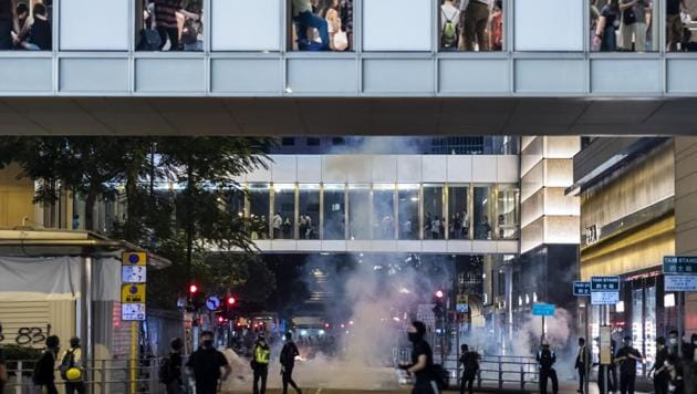 Demonstrators are shrouded in a cloud of tear gas during a protest in the Central district of Hong Kong(Bloomberg photo)