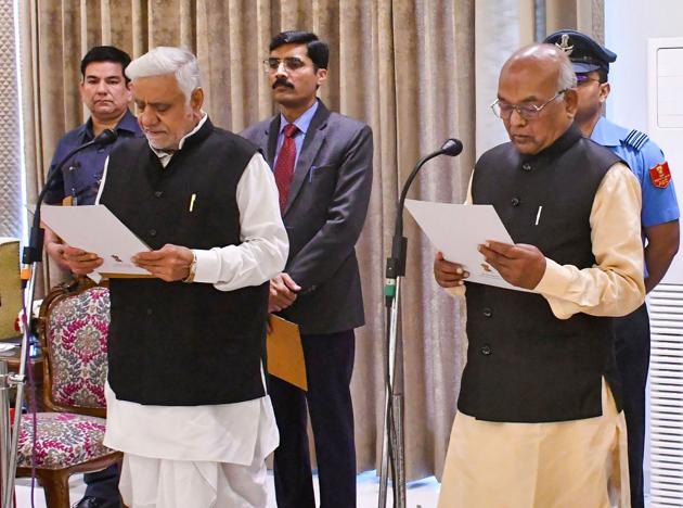 Haryana governor Satyadeo Narain Arya administers the oath of office and secrecy to Raghuvir Singh Kadian as the acting speaker of the Haryana Vidhan Sabha in Chandigarh, Monday.(PTI)