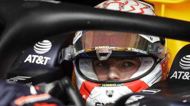 Red Bull driver Max Verstappen, of the Netherlands, sits in his car.(AP)