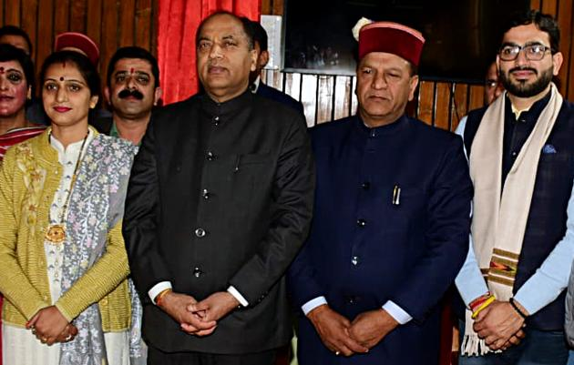 Himachal Pradesh chief minister Jairam Thakur with newly elected MLAs Reena Kashyap and Vishal Nehariya after the oath-taking ceremony at Vidhan Sabha in Shimla on Monday.(HT PHOTO)