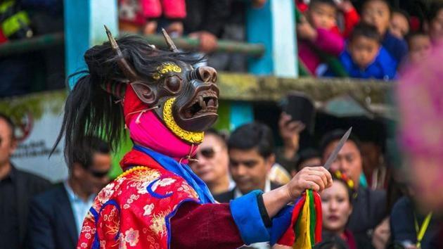 Monpa tribe dancers perform their traditional mask dance during the 2nd day of Tawang festival at Tawang in Arunachal Pradesh.(PTI)