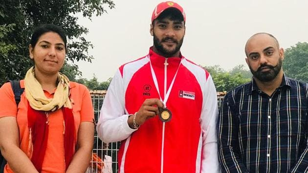 Cyclist Harsimranjit Singh with coach Satwinder Singh (right) in Ludhiana on Saturday.(HT Photo)