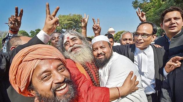 People celebrate the Ayodhya case verdict, outside the Supreme Court in New Delhi on Saturday.(PTI Photo)