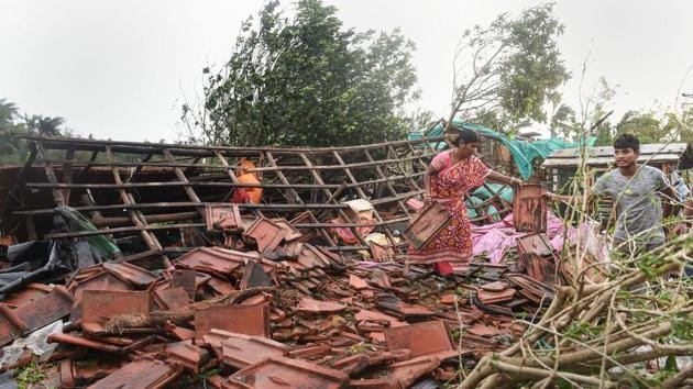 A woman stands on the remnants of her house in the aftermath of cyclone 'Bulbul', at Bakkhali, in South 24 Parganas district of West Bengal, Sunday, Nov. 10, 2019(PTI)